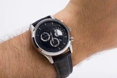 Horloge op een hand Stock Afbeelding