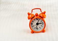 Horloge orange Photographie stock
