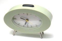 Horloge verte sur le blanc Photos libres de droits