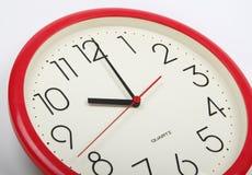Horloge-visage sur le blanc Photo stock