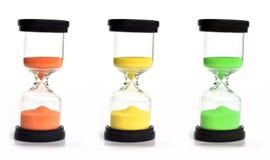 Horloges colorées de sable Photographie stock