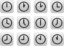 Horloges grises lustrées Photographie stock libre de droits