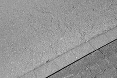 Hormigón y asfalto de piedra del pavimento Fotos de archivo