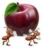 Hormigas de la historieta que llevan Apple Imágenes de archivo libres de regalías