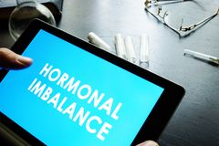 Hormonal imbalance. Hormonal imbalance sign on a tablet stock images
