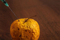 Hormone Apple on the Wood Royalty Free Stock Images