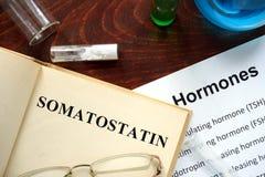 Hormone somatostatin written on book. Stock Images