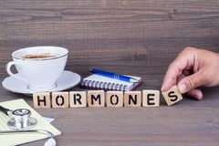 Hormones. Wooden letters on dark background. Office desk Royalty Free Stock Photography