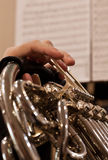 Horn fragment in the hands of a musician Royalty Free Stock Images