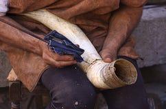 Horn maker. A music horn maker working Stock Photography