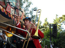 Horn player of Mucca Pazza points across the stage Royalty Free Stock Image