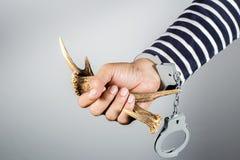 Horn und Fessel Konzept von strafbaren Handlungen Lizenzfreie Stockbilder