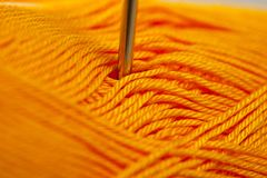Horn yarn for knitting yellow-orange bright color.  Stock Image