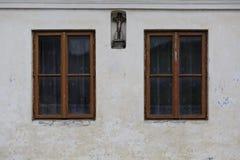 Horna Lehota village in Orva region. Traditional house with a crucifix, Orava region, Slovakia royalty free stock photo