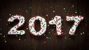 Hornada del Año Nuevo los pasteles dulces ponen letras a 2017 Imagen de archivo