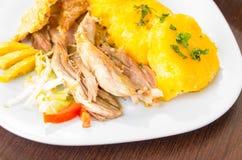 Hornado烤了猪肉典型的厄瓜多尔食物 免版税图库摄影