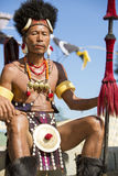 Hornbill Festival of Nagaland, India. Naga tribesman wears traditional dress at the Hornbill festival that is held annually in the 1st week of December. The royalty free stock photo