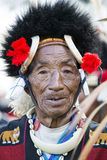 Hornbill Festival of Nagaland, India. Naga tribesman wears traditional dress at the Hornbill festival that is held annually in the 1st week of December. The stock photo