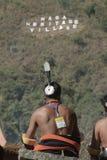 Hornbill Festival.Nagaland,India:1st December 2013 : Naga Tribal at Morong overlooking the Hill at Hornbill Festival. Hornbill Festival.Nagaland,India:1st royalty free stock photos