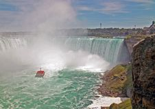 Hornblower and Niagara Falls. Hornblower at the base of Niagara`s Horseshoe Falls with a full load of tourists stock photos