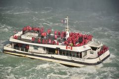 Tourists Crowd the decks of the Hornblower Ferry Boat on the Niagara River. The Hornblower struggles against the powerful current as it takes its passengers for royalty free stock photo