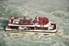 Tourists Crowd the decks of the Hornblower Ferry Boat on the Niagara River. The Hornblower struggles against the powerful current as it takes its passengers for stock photos