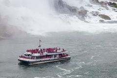 The Hornblower tour boat at the Niagara Falls, Canada. Niagara Falls, Canada - Oct 15, 2017: The Niagara Falls tour boat Hornblower at the Niagara River stock image