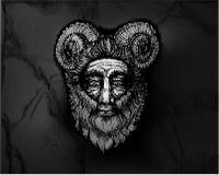 Horned божество на каменной стене Стоковая Фотография