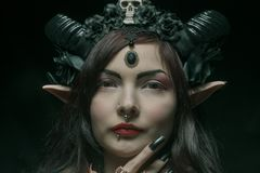 Horned asian girl. With elvish ears over dark background Royalty Free Stock Image