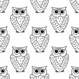 Horned owl seamless background pattern. Great horned outline owl  seamless pattern with stylized striped feathers Royalty Free Stock Images