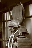 Horned samurai. Elements of Japanese armor - samurai helmet with Buffalo horns and protective mask, cuirass dou with plate shoulder protectors sode Stock Photos