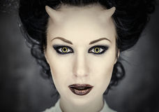 Horned woman with bright makeup Stock Photos