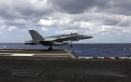 Hornet takes flight. An F-18 Hornet takes flight after a catapult launch from an aircraft carrier Royalty Free Stock Images