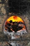 Horno con el Burning de la leña Imagen de archivo libre de regalías