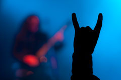 Horns up metal sign. The audience makes a horns up sign during a metal concert stock photography