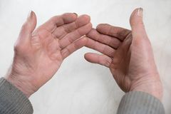 Horny worn hands of an old senior. Worker, view the hand palm Stock Images