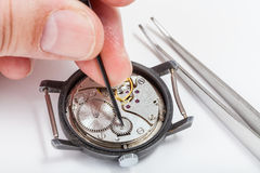 Horologer repairs old watch close up Royalty Free Stock Photography