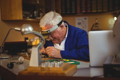 Horologist repairing a watch Stock Images