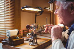 Horologist repairing a watch Stock Photography