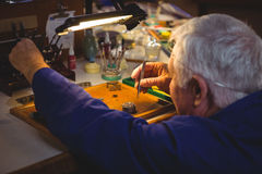 Horologist repairing a watch Stock Image