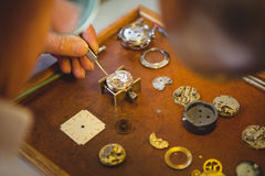 Horologist repairing a watch Royalty Free Stock Photo