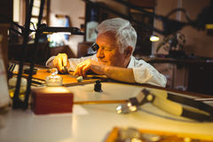 Horologist repairing a watch Royalty Free Stock Images
