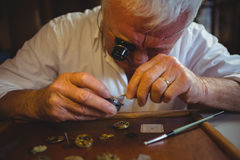 Horologist repairing a watch Royalty Free Stock Image