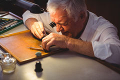 Horologist repairing a watch Royalty Free Stock Photos