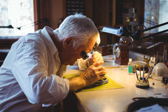 Horologist repairing a watch Royalty Free Stock Photography
