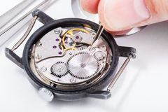 Horologist repairs old watch close up Stock Image
