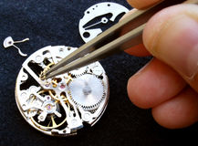 Horology. Close up of watchmaker Working On A vintage Mechanical Watch Royalty Free Stock Photo
