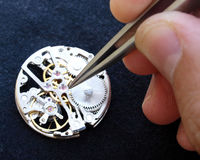 Horology. Close up of watchmaker working on vintage watch Stock Photography