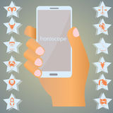 Horoskop på mobil Arkivbilder