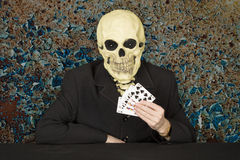 Horrible cardsharper in mask - skull Stock Photo